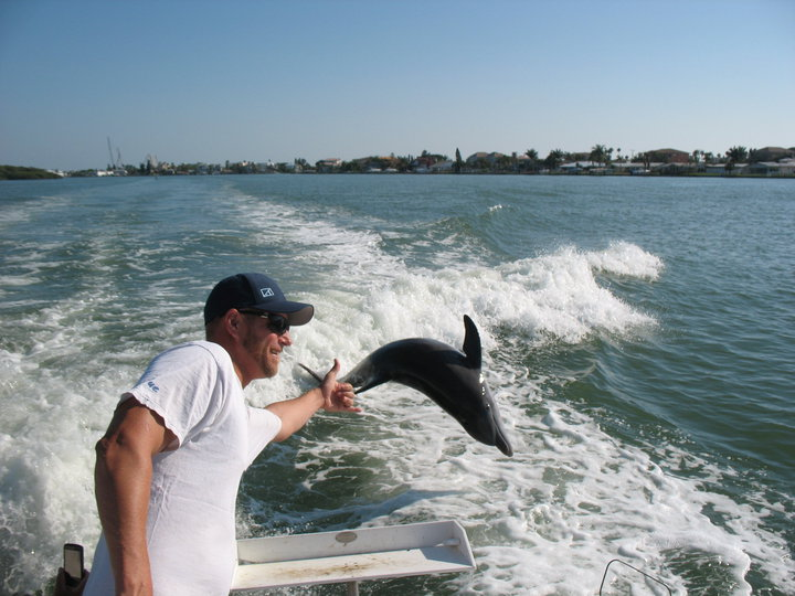 Dolphin jumping our wake!